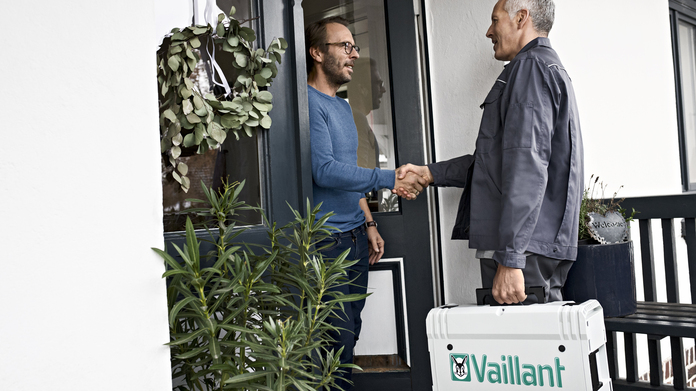 A Vaillant partner is visiting a customer at his house